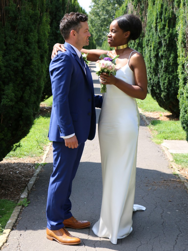 silk wedding dress and mens blue wool suit